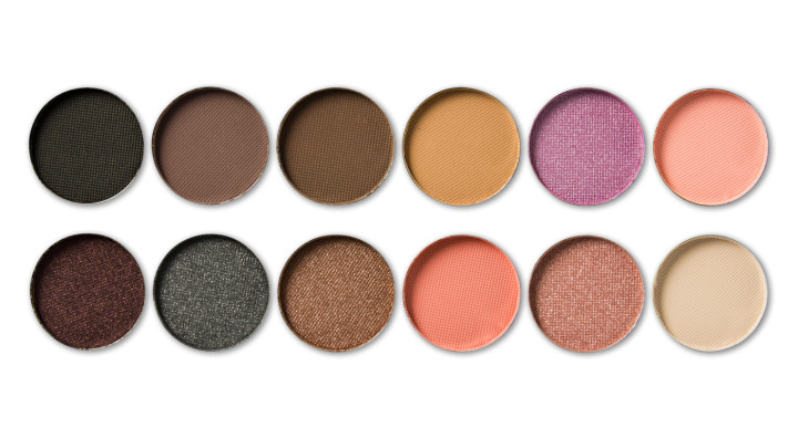 Palette of colorful eye shadows isolated on white