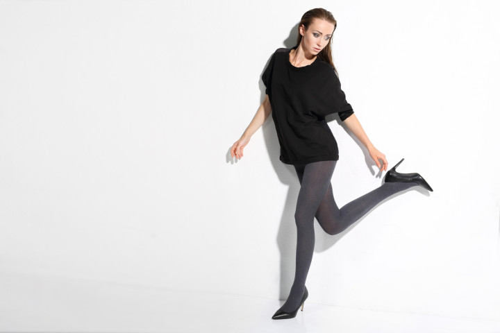 Slim woman's legs in pantyhose