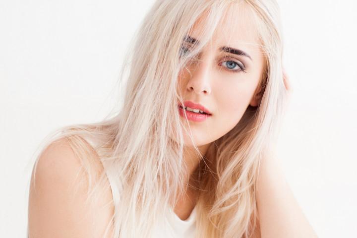 disheveled blonde calmly and trustingly looks