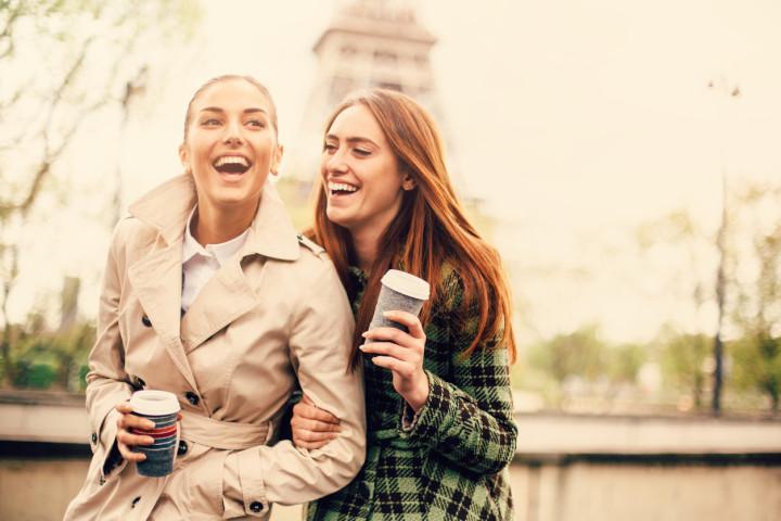 Friends drinking coffee in Paris