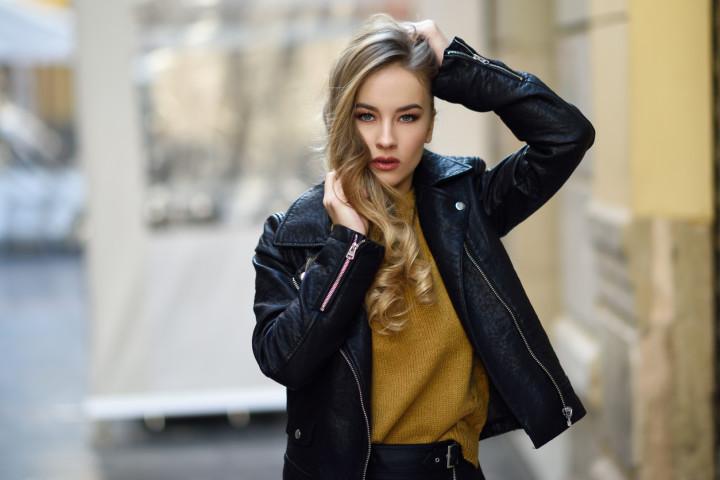 Beautiful blonde russian woman in urban background