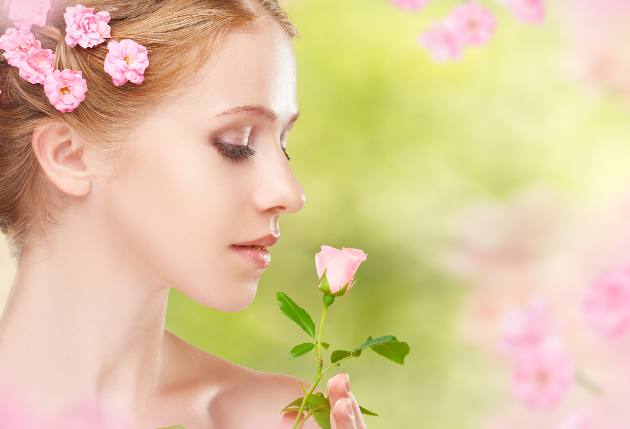 Beauty face of young beautiful woman with pink flowers