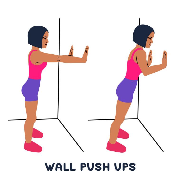 壁腕立て伏せをする女性